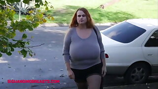 Amazing huge tits fighting under her tight pullover