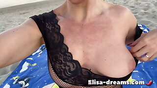 Naughty girl at the beach with random guys