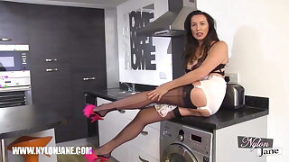Busty Milf with long legs wrapped in fully fashioned nylons